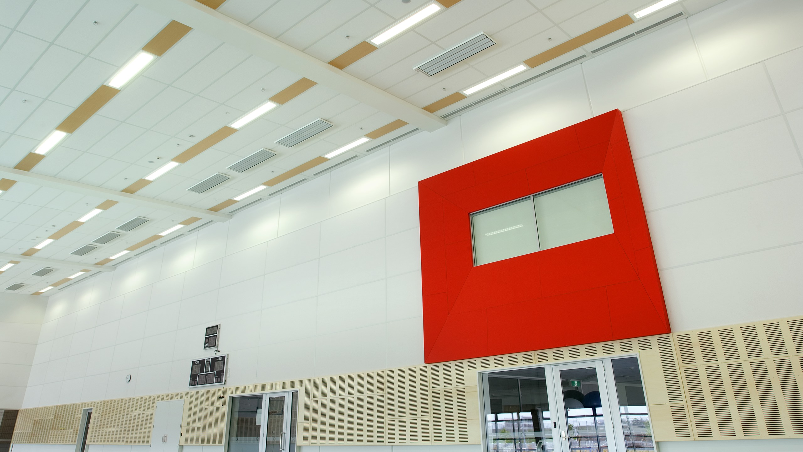 Hobsonville Point Intermediate School Gymnasium showing Triton Sports panels installed between lighting strips